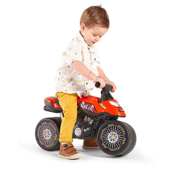Child playing with Dakar Motorcycle Balance Bike Falk Toys 406D