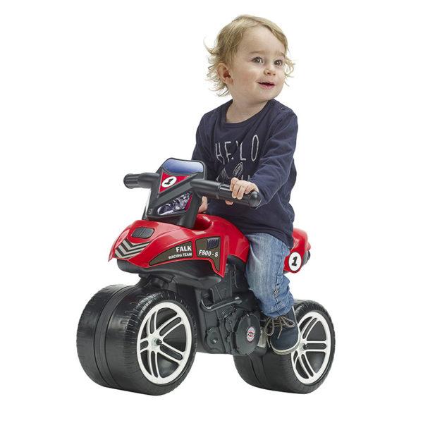 Little boy playing with Falk Racing Team 500 Red Balance Bike