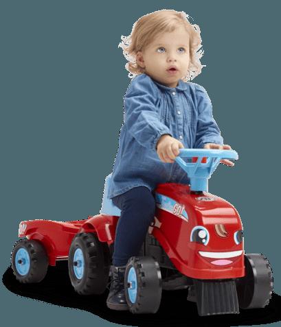 bébé sur un porteur rouge Falk Toys