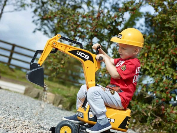 Little boy playing with backhoe JCB 115A outdoors