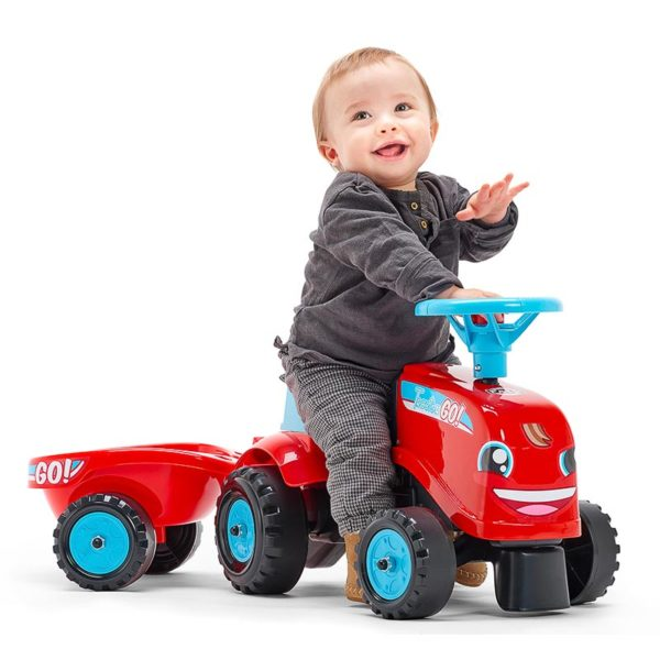Child playing with ride-on Tractor Go! Falk Toys 200B