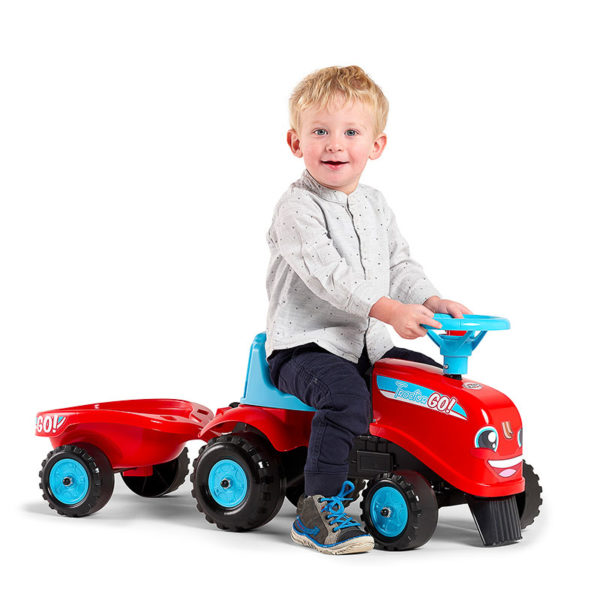 Little boy playing with ride-on Tractor Go! 200B
