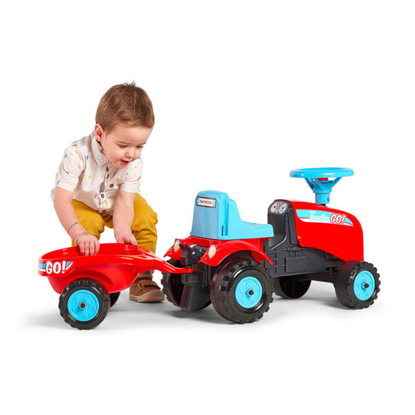Little boy playing with ride-on Tractor Go! Falk Toys 200B