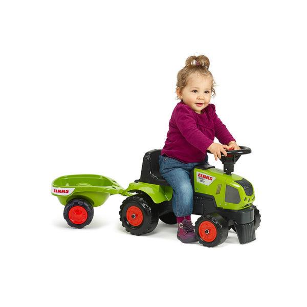 Enfant jouant avec Porteur tracteur Baby Claas 1012B