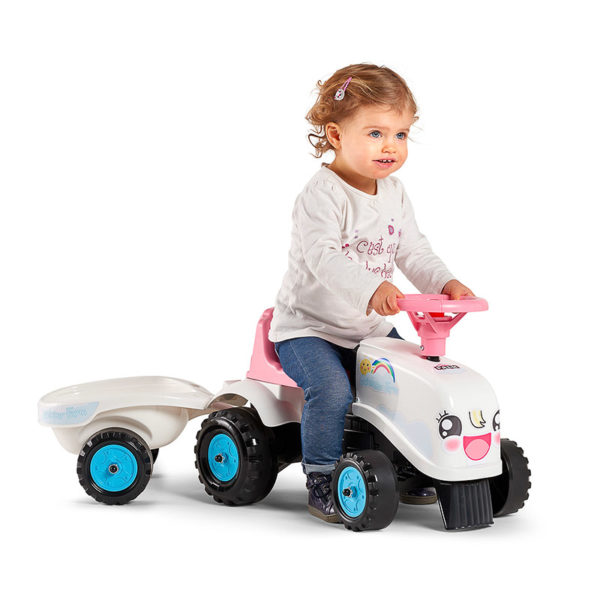 Child playing with Rainbow Farm ride-on tractor 206B