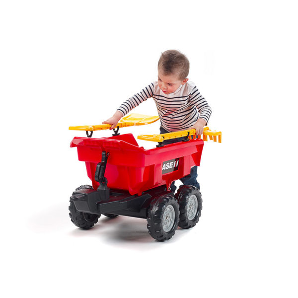 Child playing with Case IH Maxi 940CI tilting trailer