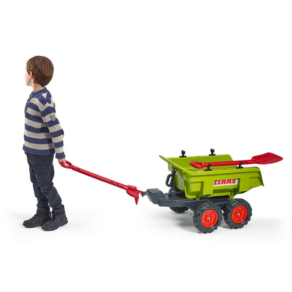 Child playing with Claas Maxi 940CH Tilting trailer