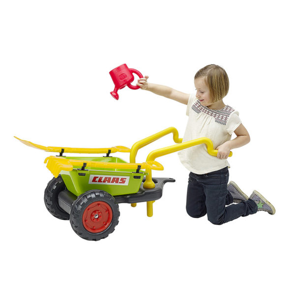 Child playing with Claas wheelbarrow trailer 295VC