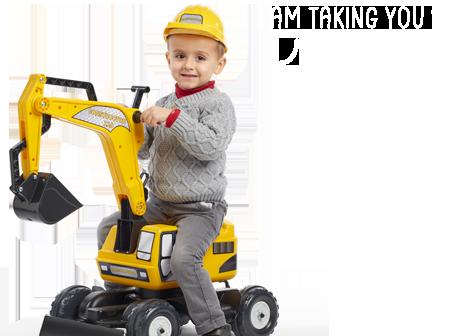 Enfant sur un jouet roulant Falk jaune