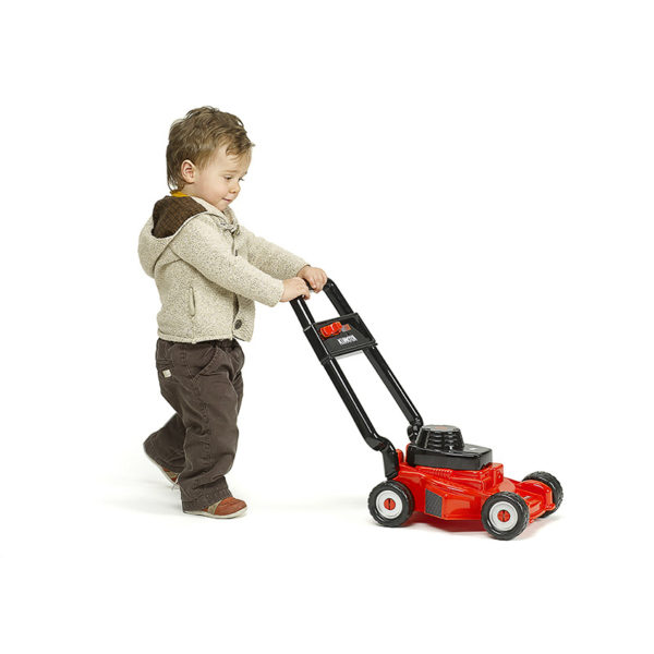 Child playing with Kubota 3095 Lawn mower