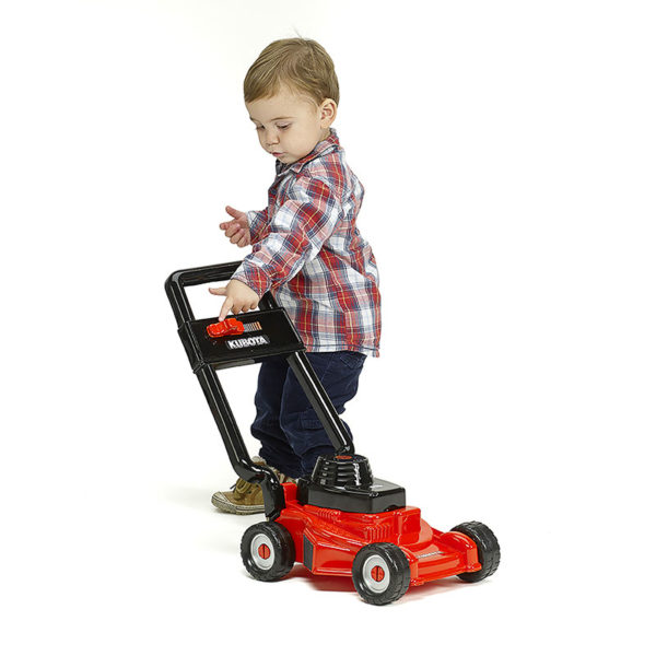 Child playing with Falk Toys Kubota 3095 Lawn mower