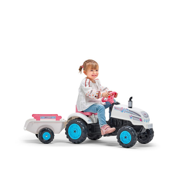 Little girl playing with Butterfly Farmer 2042AB Pedal Tractor