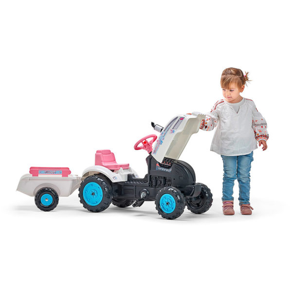Little girl playing with Falk Toys Butterfly Farmer 2042AB Pedal Tractor