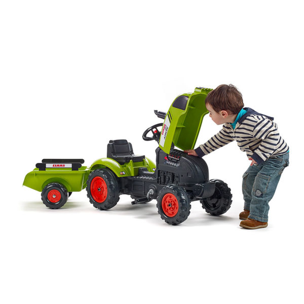 Child playing with Falk Toys Claas 2041C Pedal tractor