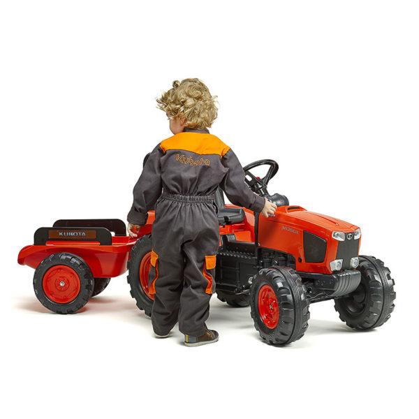 Child playing with Falk Toys Kubota 2060AB pedal tractor