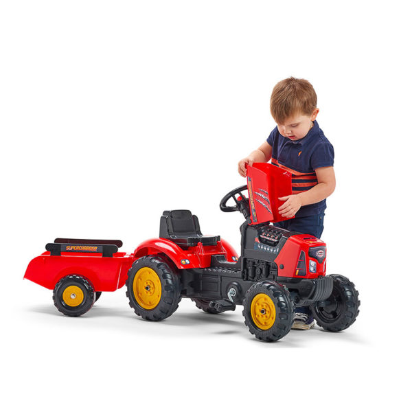 Child playing with Falk Toys Supercharger 2030AB pedal tractor
