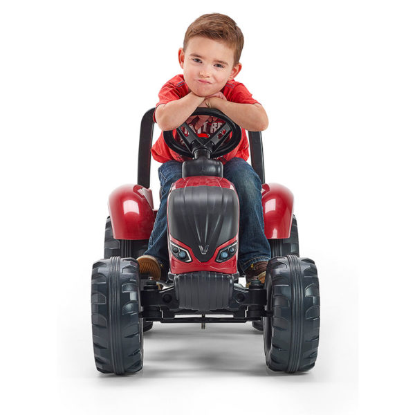 Little boy playing with Valtra 4000AB Pedal Tractor