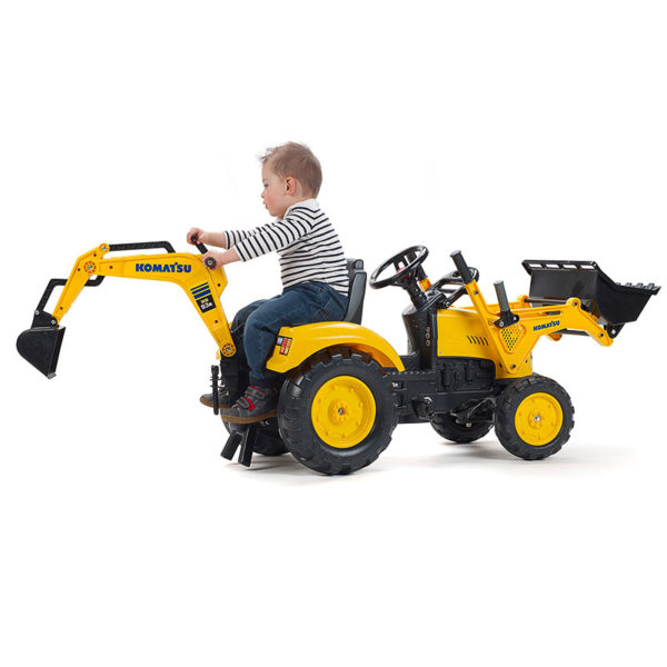 Child playing with Falk Toys Komatsu 2086N pedal backhoe loader