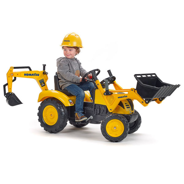 Little boy playing with Komatsu 2086N pedal backhoe loader