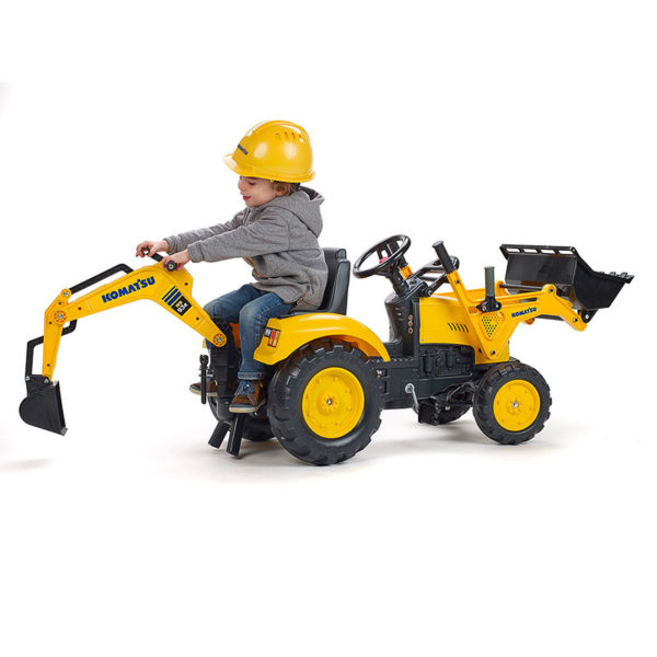Little boy playing with Falk Toys Komatsu 2086N pedal backhoe