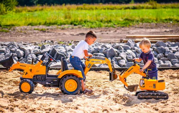 Children playing with Komatsu 2086N pedal backhoe loader outdoors