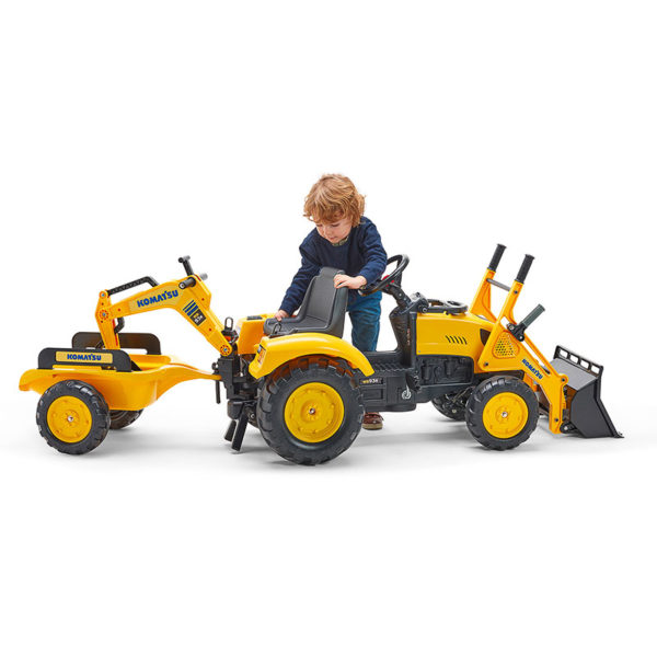 Child playing with Falk Toys Komatsu 2086Y pedal backhoe loader