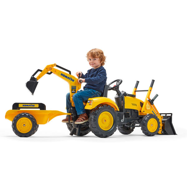 Little boy playing with Komatsu 2086Y pedal backhoe loader