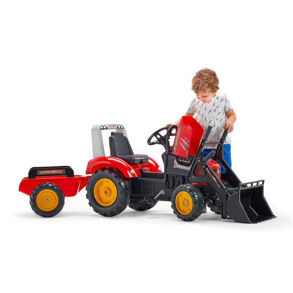 Child playing with Falk Toys Supercharger pedal tractor with front loader and trailer 2020M