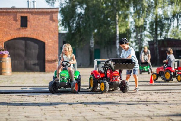 Child playing with Supercharger pedal tractor with front loader and trailer 2020M outdoors