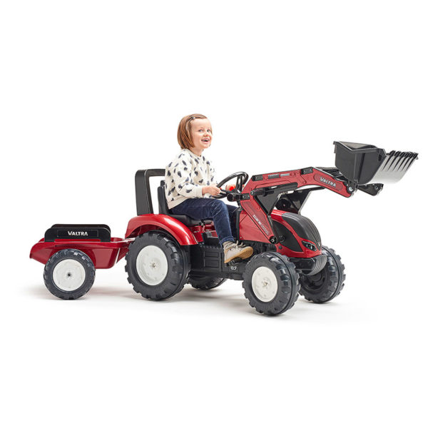 Child playing with Valtra 4000AM Pedal Backhoe