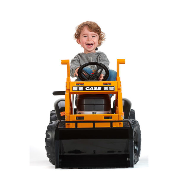 Child Playing with Falk Toys Case Construction 997N Backhoe