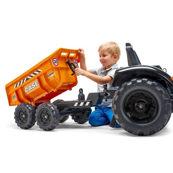 Child playing with the Case Construction 997W trailer backhoe loader